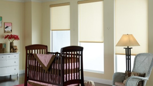 Translucent shades allow the light to filter through, but prevent any actual see-through. This example of a baby's crib room demonstrates the effect. (Picture: Mermet® Vizela)